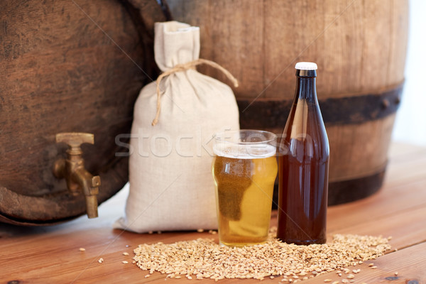 Stock photo: close up of beer barrel, glass, bottle and malt
