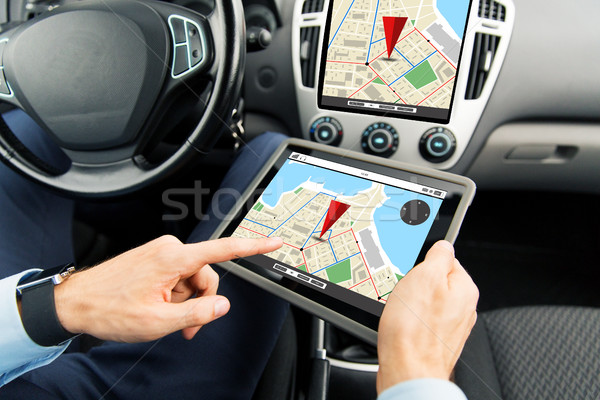 close up of man with tablet pc in car stock photo © Syda