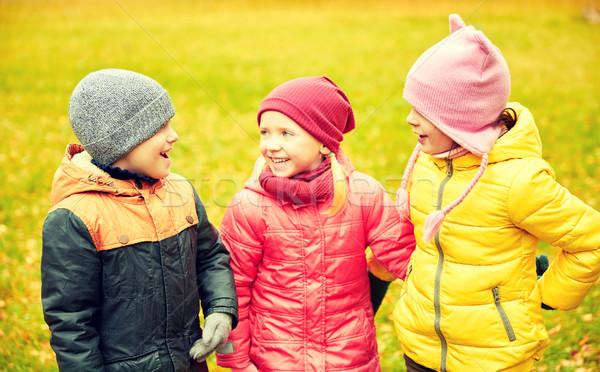 Gruppo felice bambini autunno parco infanzia Foto d'archivio © dolgachov