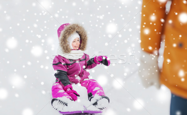 happy little kid on sled outdoors in winter Stock photo © dolgachov