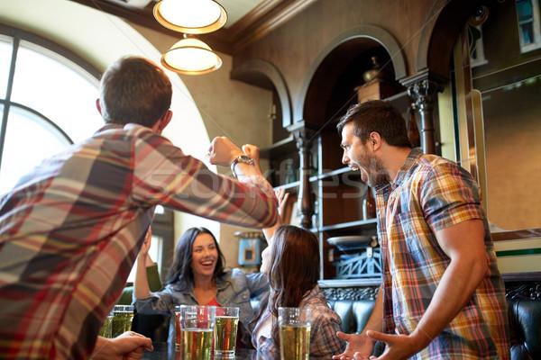 Feliz amigos cerveza bar pub Foto stock © dolgachov