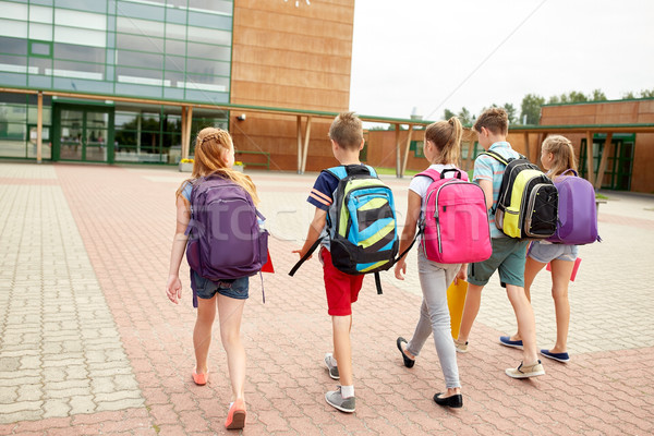Stock photo: group of happy elementary school students walking