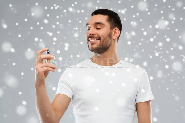 Sorridente homem masculino perfume neve perfumaria Foto stock © dolgachov