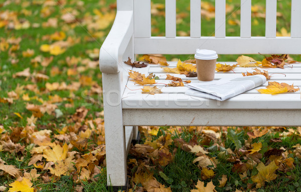newspaper and coffee cup on bench in autumn park Stock photo © dolgachov