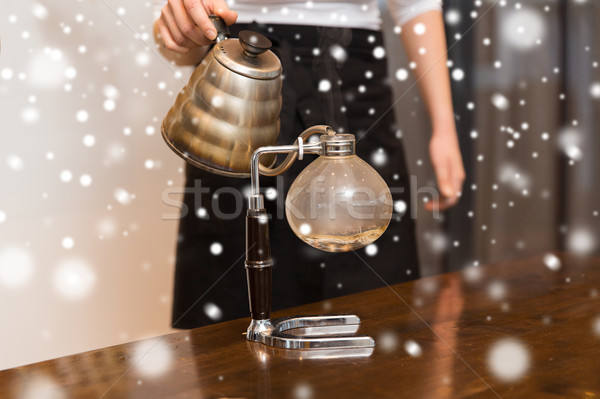 close up of woman with siphon coffee maker and pot Stock photo © dolgachov