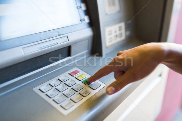 close up of hand entering pin code at atm machine Stock photo © dolgachov