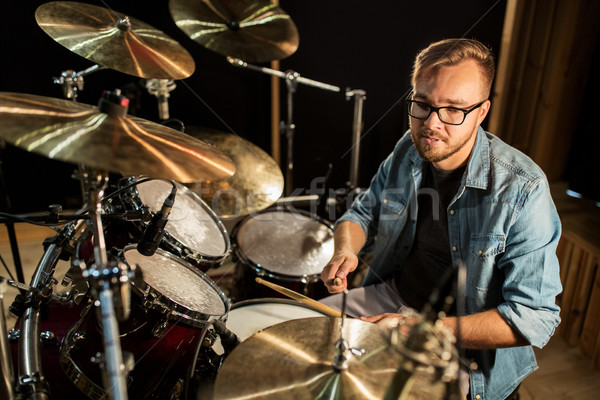 Stock photo: male musician playing drums and cymbals at concert