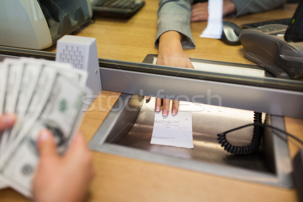 bank clerk giving receipt to customer with money Stock photo © dolgachov