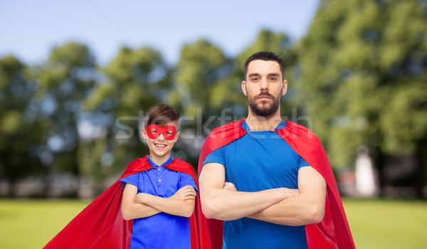 man and boy wearing mask and red superhero cape Stock photo © dolgachov