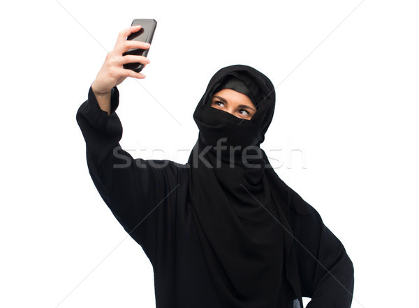 muslim woman in hijab taking selfie by smartphone Stock photo © dolgachov
