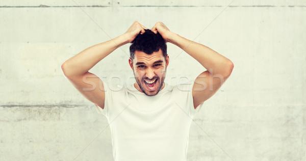 Crazy uomo tshirt grigio emozioni Foto d'archivio © dolgachov
