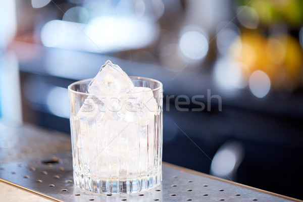 glass with ice cubes at cocktail bar Stock photo © dolgachov
