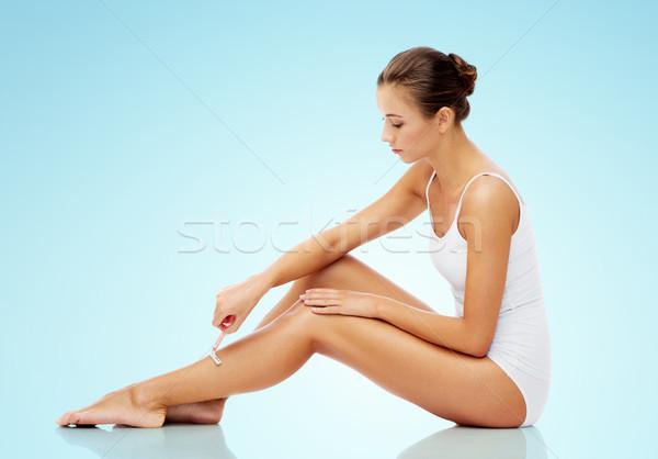Kadın güvenlik ustura bacaklar mavi insanlar Stok fotoğraf © dolgachov