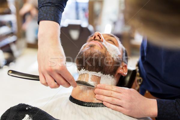 Férfi fodrász egyenes borotva szakáll emberek Stock fotó © dolgachov