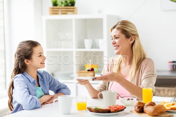 happy family with birthday cake at home kitchen Stock photo © dolgachov