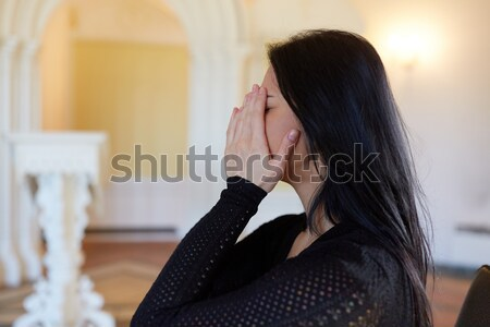 Triste mujer rezando dios iglesia Foto stock © dolgachov