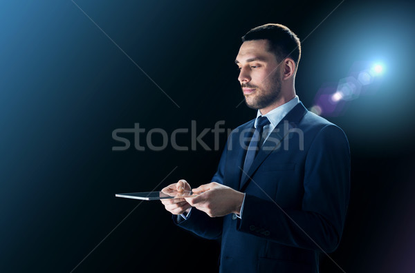 businessman in suit with transparent tablet pc Stock photo © dolgachov