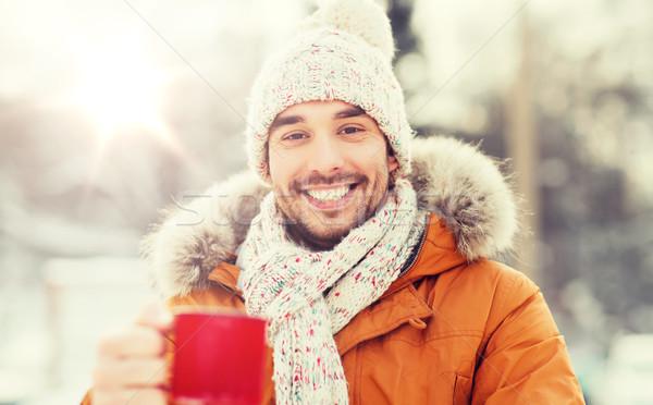 Boldog férfi teáscsésze kint tél emberek Stock fotó © dolgachov