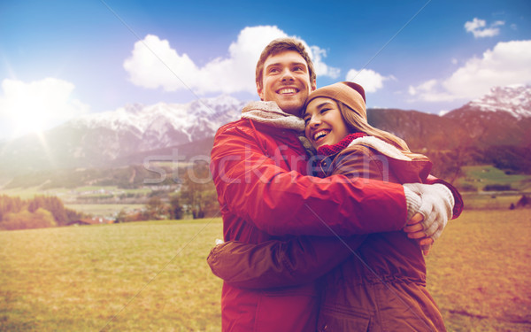 happy couple hugging over alps mountains Stock photo © dolgachov