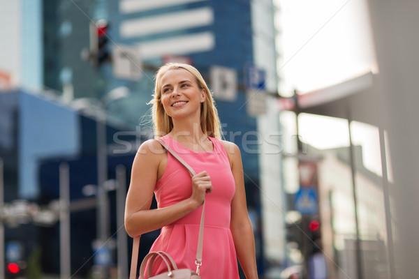 happy smiling young woman on city street Stock photo © dolgachov