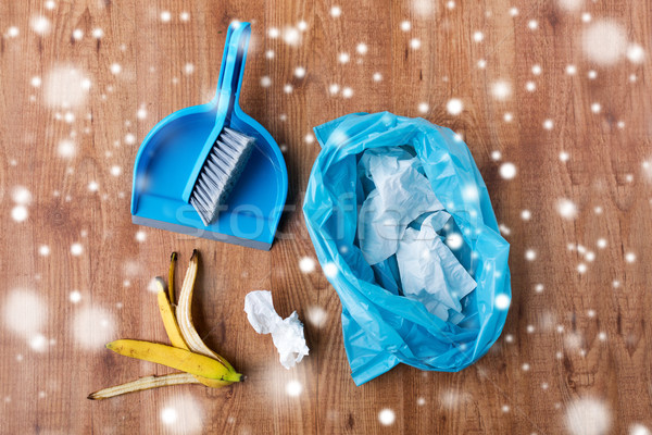 rubbish bag with trash, whisk and dustpan on floor Stock photo © dolgachov