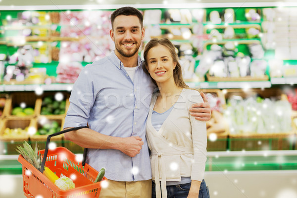 happy couple with food basket at grocery store Stock photo © dolgachov