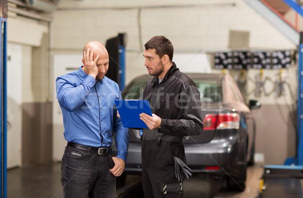 auto mechanic and customer at car shop Stock photo © dolgachov