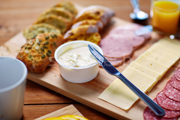 Stock photo: cream cheese and other food on table at breakfast