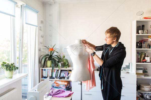 fashion designer with dummy making dress at studio Stock photo © dolgachov