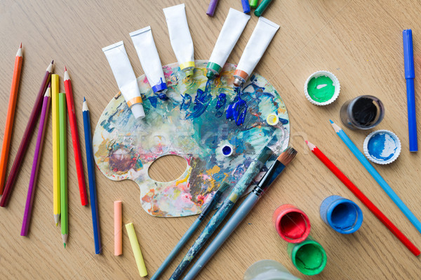 color palette, brushes and paint tubes on table Stock photo © dolgachov