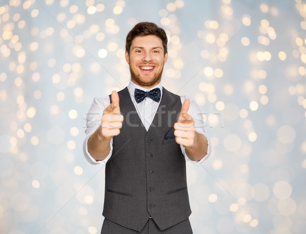 happy man in festive suit pointing in camera Stock photo © dolgachov