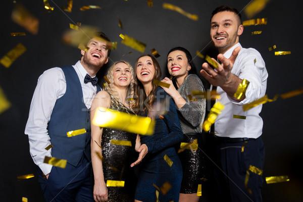 Felice amici party confetti nero celebrazione Foto d'archivio © dolgachov