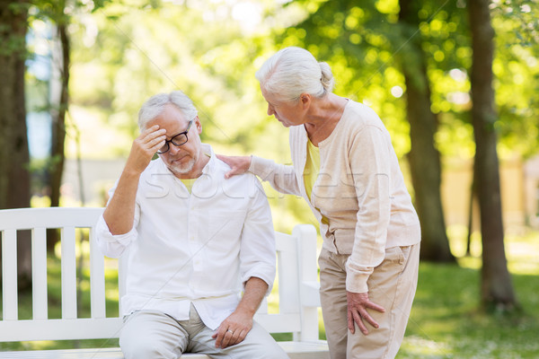 senior man suffering from headache outdoors Stock photo © dolgachov