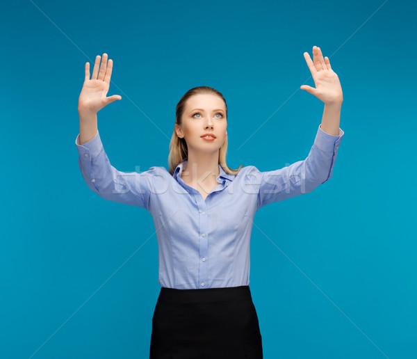Vrouw werken iets denkbeeldig heldere foto Stockfoto © dolgachov