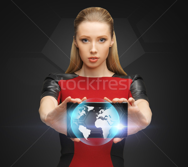 woman holding tablet pc with sign of globe Stock photo © dolgachov