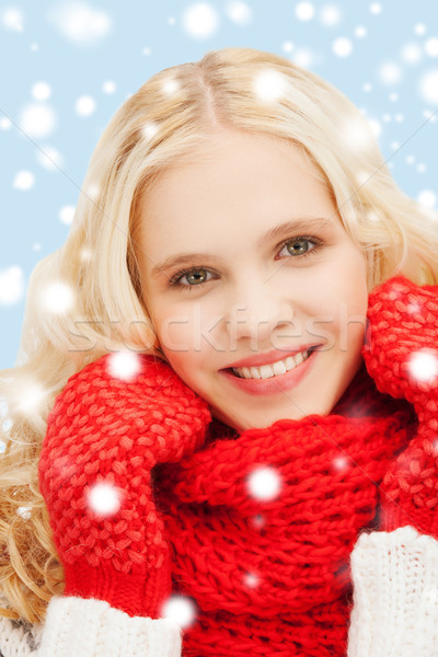 teenage girl in red mittens and scarf Stock photo © dolgachov