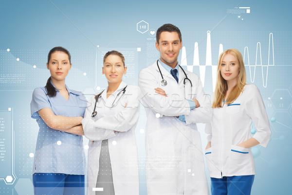 Jonge team groep artsen gezondheidszorg geneeskunde Stockfoto © dolgachov
