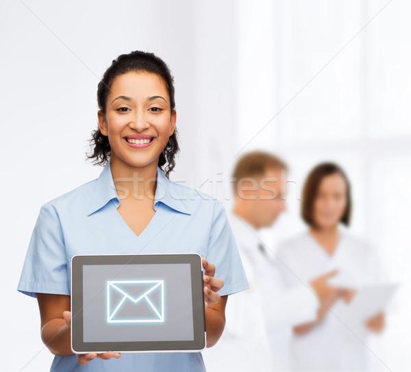 Mosolyog női orvos nővér táblagép egészségügy Stock fotó © dolgachov