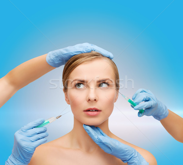 woman face and beautician hands with syringe Stock photo © dolgachov