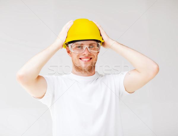 男性 ビルダー 保護眼鏡 黄色 ヘルメット 建物 ストックフォト © dolgachov