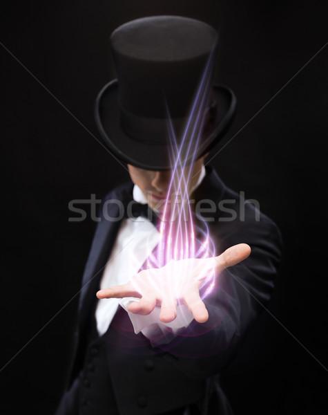 Bűvész tart valami pálma kéz mágikus Stock fotó © dolgachov