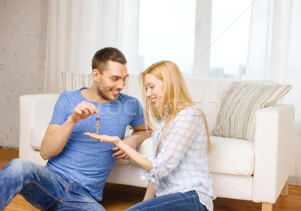 man giving keys to girlfriend or wife at home Stock photo © dolgachov
