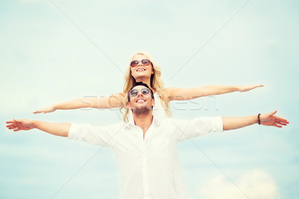 couple holding hands up at sea side Stock photo © dolgachov