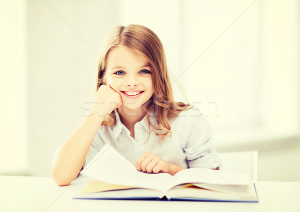 Stock photo: little student girl studying at school