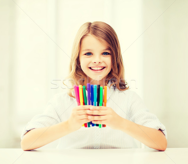 Stock photo: girl showing colorful felt-tip pens