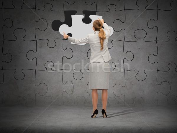 Imprenditore suit pezzo puzzle business sviluppo Foto d'archivio © dolgachov