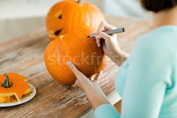 close up of woman with pumpkins at home Stock photo © dolgachov