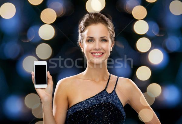 Mosolygó nő estélyi ruha okostelefon technológia kommunikáció ünnepek Stock fotó © dolgachov