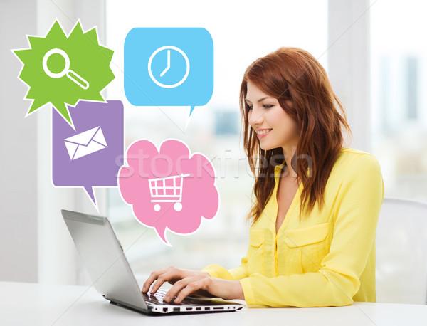 улыбающаяся женщина портативного компьютера домой люди технологий интернет Сток-фото © dolgachov