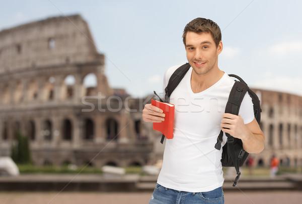 счастливым молодым человеком рюкзак книга люди Сток-фото © dolgachov